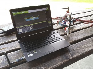 A grounstation setup with APM Mission Planner, 433MHz wireless data link, and a quadcopter with a Crius AIO board running MegaPirate 2.9R8
