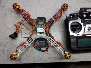 The flight controller installed on the frame, with the receiver wiring going to the 2.4GHz receiver. If you don't know which channel on the receiver is used for which function, check your transmitter for a channel output monitor. Note that your transmitter should be set for a new airplane model, NOT a helicopter model.