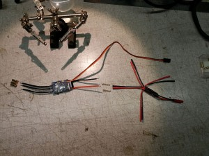 This is where our connectors go on the ESC. Note the two male connectors on the power leads. The star-shaped cable on the right is our power distribution cable.